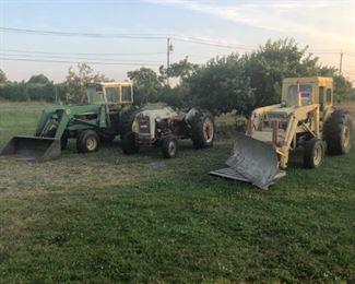 3 working tractors