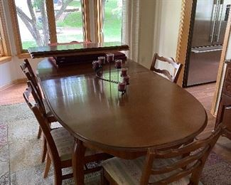 Phoenix Chair Co. (Sheboygan, WI) dining room table with 6 chairs, leaves, and protective pad covers.