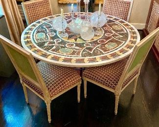 Pietra Dura Italian dining table with gilt scrolled iron base.