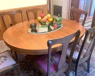 antique oak table with 6 needlepoint seat chairs