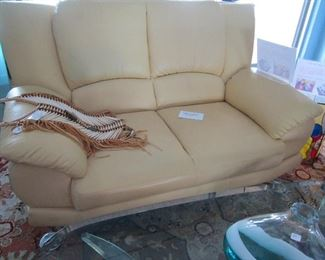 Light yellow chrome legs leather settee