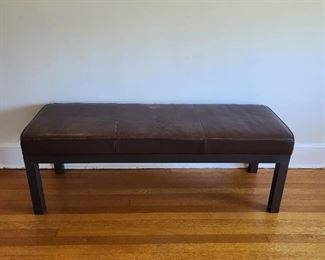 "leather bench with metal legs...55"" wide x 19"" deep x 19"" high. Scratches and water marks on the top."