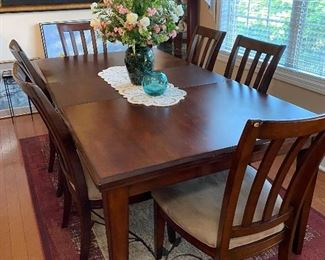 Dining table and 6 chairs.  Shown with the one leaf inserted.