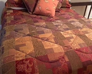 Queen comforter set over like new Sealy Queen mattress, boxsprings and frame.