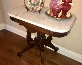 Fenton Cranberry Glass on a Marble Top Table