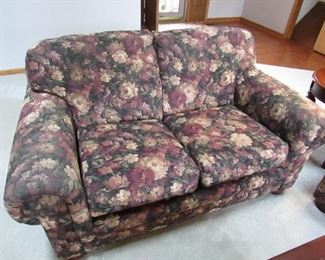 """""""Bradington Young"""" floral upholstered love seat. 58"""" long x 39"""" wide. PRICE: $195.00"""