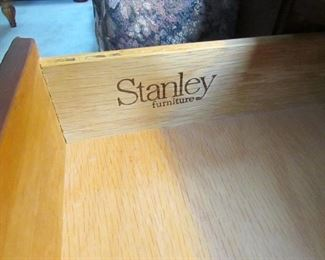 Label to drawer of end table.