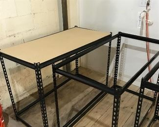 Several unassembled muscle racks
