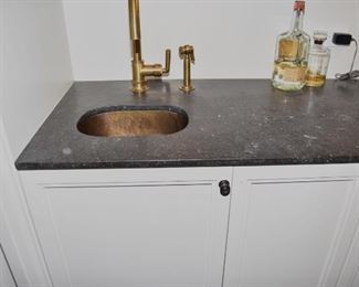 $750 to include stone counter, faucet and sink (Refrigerator under counter not included.)