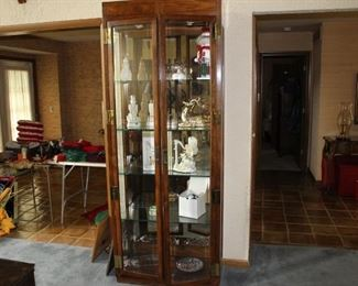 Lighted display cabinet with glass shelves and doors