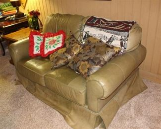 Green leather love seat