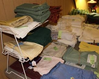 Lots of sheets, bedding, towels