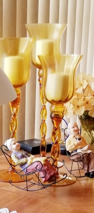 $5 granny and grampa on rockers $20 - 3 amber candle sticks
