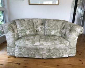 Price: $400. Beautiful tufted sofa in light celery green toile (actual fabric color is lighter than photo). 33H x 81W x 43D. Condition is very good or better.