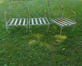Set of three outdoor iron seats designed to work together as settee or separately