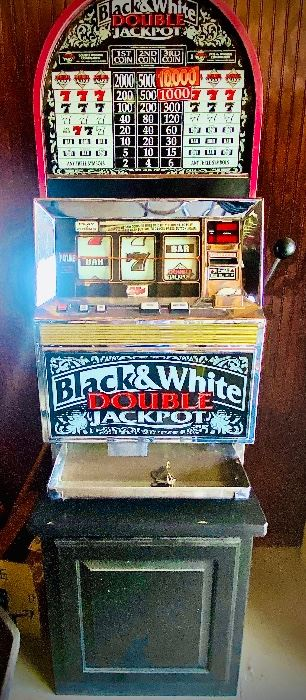 Black and White double jackpot slot Machine in perfect working condition! It can be yours by bidding on the online auction- follow this link to bid!  https://www.estatesales.net/TX/Weatherford/76086/marketplace/26689