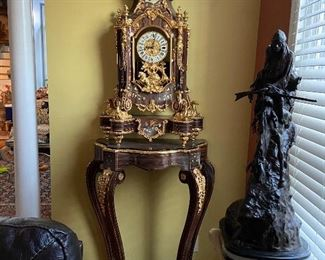 "Antique floor BRASS ITALIAN clock.    INLAID WOOD with matching DISPLAY TABLE    ""GORGEOUS !!        $8500."