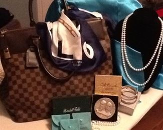 Luis Vuitton Bag  ( X-LARGE)         $3250.   AUTHENTIC with Dust Bag                                                                    C.D.Peacock Commemorative 100 yr Silver Lg. COIN in original box       $500.