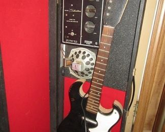 How cool is this? Silvertone guitar with case that has speaker and amp built in.