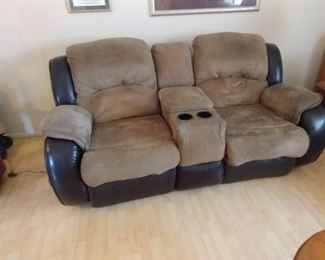 """Leather and Faux Suede Reclining Love Seat. 78"""" by 39"""" by 43"""" Asking $175.00"""