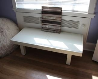 Low white table with sliding tops