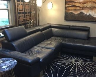 Black leather sofa with built in headrest $1250