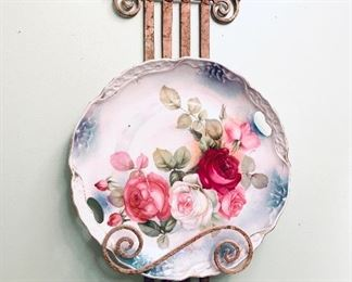 "ROSE PLATE WITH STAND. 10.5"" w plate 20""t stand. $45"