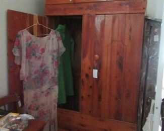 Pine wardrobe  with clothes poles inside.