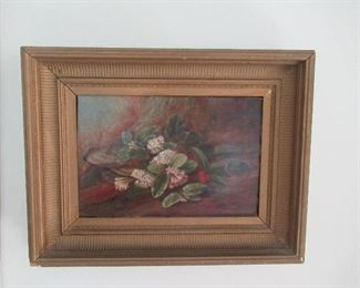 Floral oil on canvas with unknown artist.