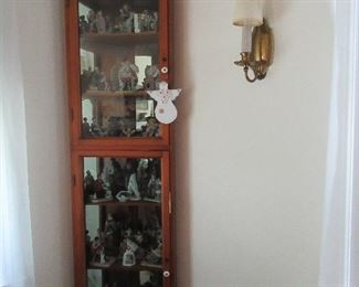 Two door Corner china cabinet with glass shelves.