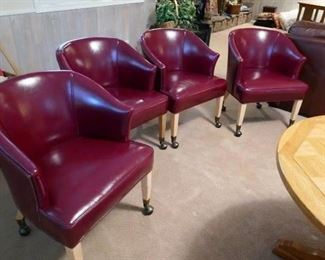 $200 - Set of four rolling club chairs.  Oxblood red faux leather upholstery with nailheads. Excellent condition.