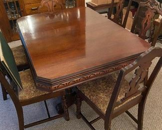 Antique dining room table and chairs -- table cover was always on it so table top never had direct contact with anything! Penn Table Company, Huntington, West Virginia. 42 x 58.