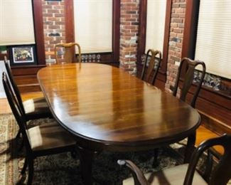 Dining Room Table with 2 arm chairs and 4 side chairs.