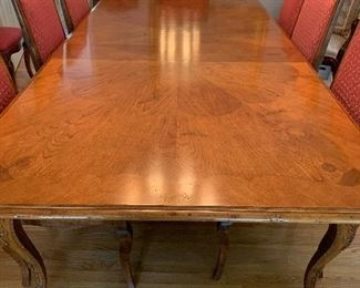 Baker table with 12 chairs. 10 side chairs with two arm chairs three leaves. $ 2200 for all