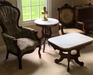 Empire and victorian pieces.  Victorian carved arm chair by Kimbell furniture company, 1840's tea table with marble top wood; walnut, round table 1840's style, empire style arm chair estimated date 1840