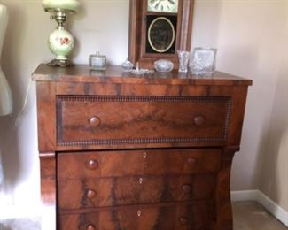 BEAUTIFUL 1840'S EMPIRE BUTLERS CHEST, INCLUDES TOP DRAWER FLIP DOWN SECRETARY WITH PIGEON HOLES.  SHOWN WITH FLAME MAHOGANY SETH THOMAS CLOCK.