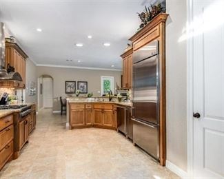 WHAT is underneath these cabinets and behind that door?