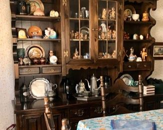 Colonial dining table, chairs & hutch packed with collectibles