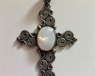 $60  Mexico Cross pendant with swirly border mother of pearl center
