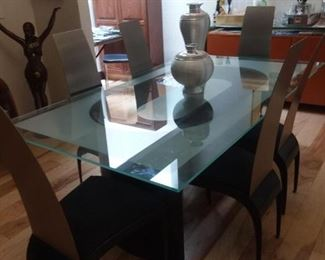 Glass and stainless dining table with six chairs