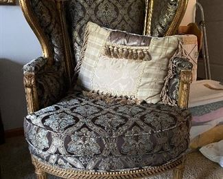 Antique wing back chair and throw pillow