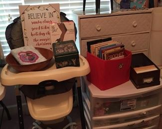 High Chair, Booster Seat, Plastic Storage Full of Artificial Flowers, Craft Books