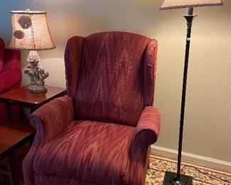 Wingback chair and floor lamp.