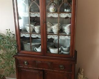 . . . a beautiful Duncan Pfyfe china cabinet filled with treasures