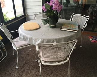 . . . this beautiful wrought-iron patio set has never seen the outdoors!