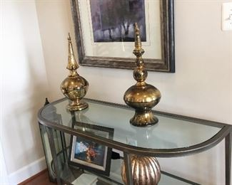 $595 Two-tier glass/metal console table with urns and painting (Refer to photo #15 with questions for all items pictured)
