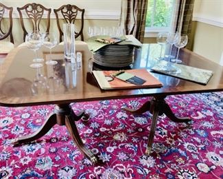 """Henredon Banded Mahogany Dining Table with Double Pedestal Base with brass tipped feet on castors,  68x46 and two  24"""" leaves plus 12x10.8 Signed Persian Rug, hand knotted"""
