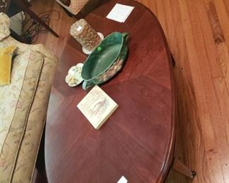 Rosevilled poinsettia on nice oval coffee table with inlaid legs
