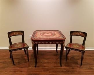 Games Table Italian with 2 chairs. Table has multiple tops with chess/checker, top design and roulette betting table