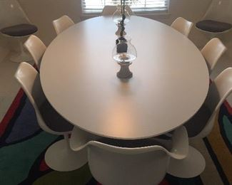 Knoll Saarinen Dinning Table with Knoll Saarinen Tulip Chairs.  There are 8 armless and 2 with Arms.  They are all swivel. Purchased in 1970/1971